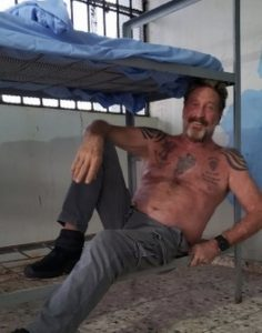 John McAfee commit suicide