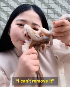 She tries to eat the octopus alive