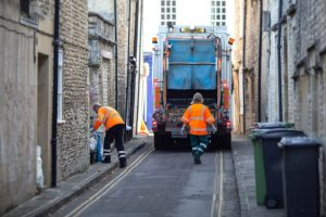 Bin-men-Rubbish-collectors-or-garbage-men-collecting-household-waste-and-recycling-in-the-Market-To